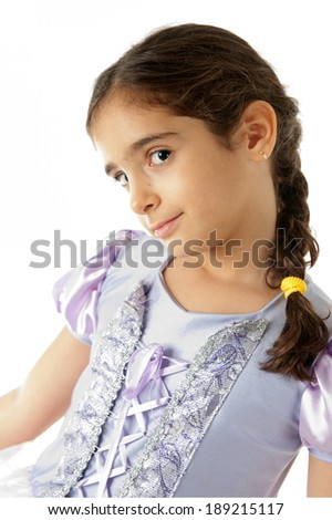 Cute child smiling using foil weave in the hair. - stock photo