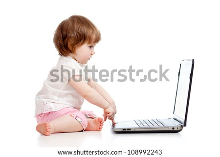cute child using a laptop - stock photo