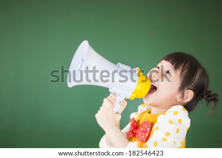 cute child  using a megaphone in a classroom - stock photo