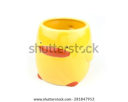 Cute coffee cup or mug isolated on white background. For pencils color box or holder. In yellow duck shape ceramics. Close up. - stock photo