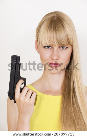 Cute confident policewoman holding gun - stock photo