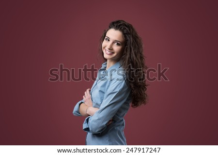 Cute confident teenager posing with arms crossed - stock photo