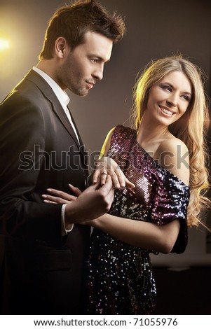 Cute couple during engagement - stock photo