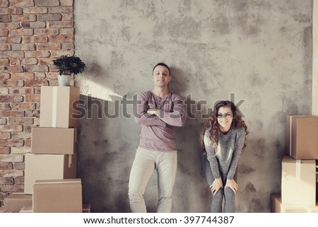 Cute couple during moving home - stock photo