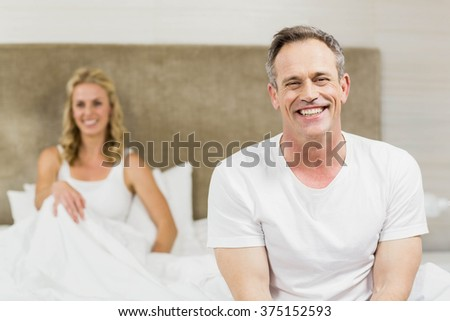 Cute couple having fun in their room - stock photo