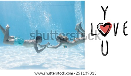 Cute couple holding hands underwater in the swimming pool against cute valentines message - stock photo