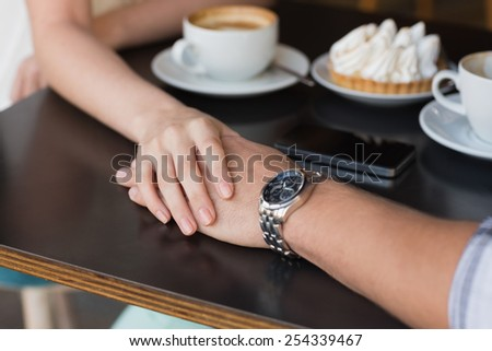 Cute couple on a date at the cafe - stock photo