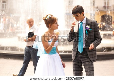 cute couple  on background fountain - stock photo