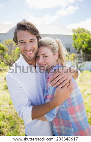 Cute couple spending time together in their garden on a sunny day - stock photo