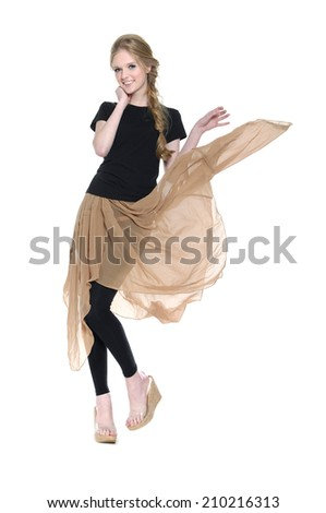 Cute elegant woman in black dress having fun, Full length portrait - stock photo