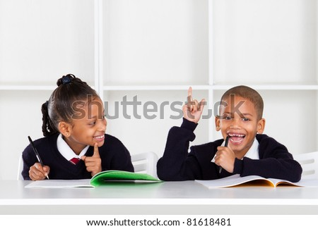 cute elementary school kids in classroom - stock photo