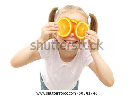 cute excited funny girl wearing glasses made of orange - stock photo