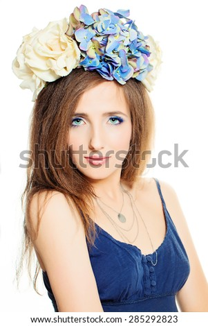 Cute Face. Fashion Woman with Makeup and Hairstyle with Flowers - stock photo
