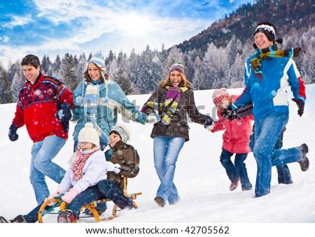 cute family having fun in the snow - stock photo