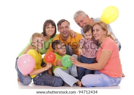 cute family of a six with balloons - stock photo