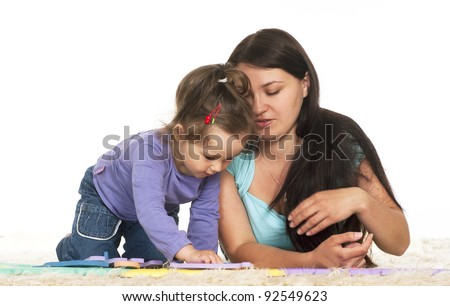 cute family of a two playing on the carpet - stock photo