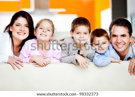 Cute family portrait with three kids smiling - stock photo
