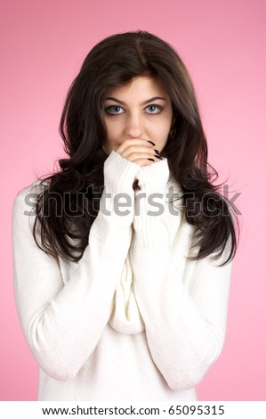 Cute female with white sweater over pink background - stock photo