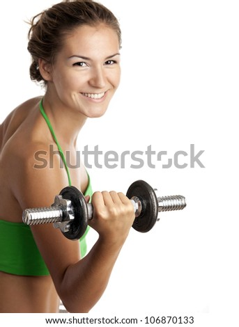 Cute fitness girl working out with dumbbells over white background - stock photo
