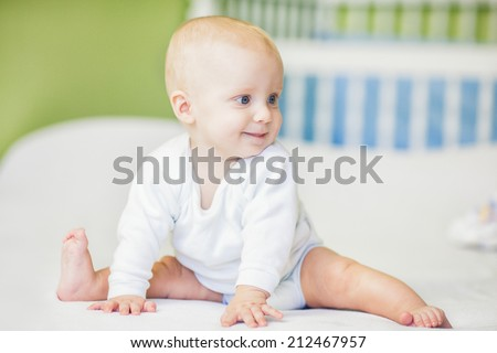 Cute five-month-old baby boy. - stock photo