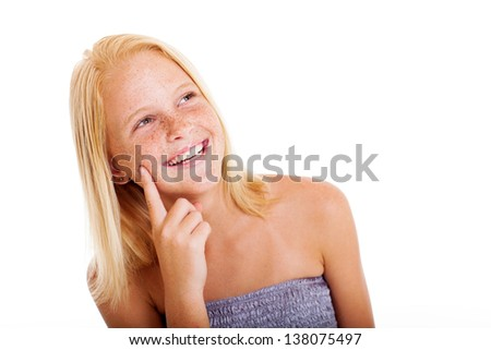 cute freckled pre teen girl looking up - stock photo