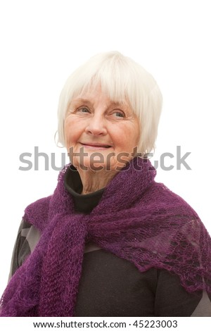 Cute friendly older woman looking  on white background - stock photo