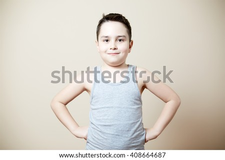 cute funny kid with hands on hips - stock photo