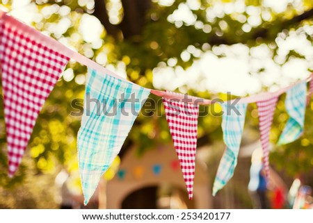 cute garland of colored flags - stock photo