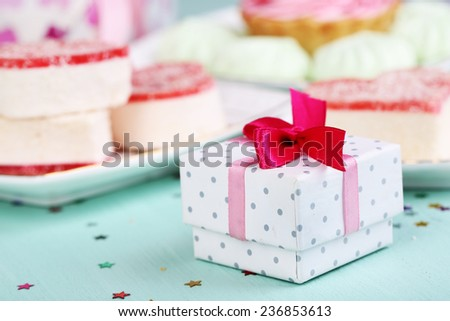 Cute gift on birthday table close-up - stock photo