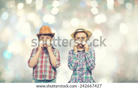 Cute girl and boy wearing shirt hat and mustache - stock photo