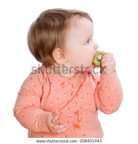 cute girl biting kiwi on a white background - stock photo
