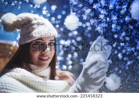 cute girl decorates the Christmas tree with balls - stock photo
