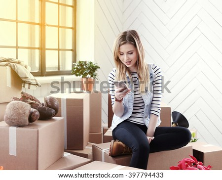Cute girl during moving home - stock photo
