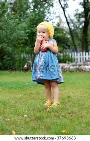Cute girl eating fresh apples - stock photo
