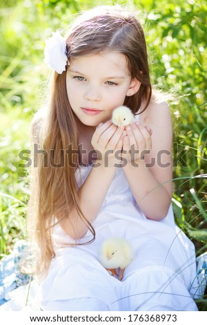 cute girl holds  little chicken - stock photo