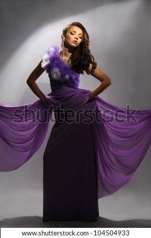 cute girl in a dress on a gray background - stock photo
