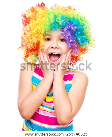 Cute girl in clown wig, isolated over white - stock photo