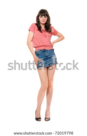 Cute girl in jeans mini skirt. Isolated - stock photo