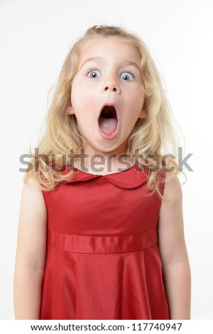 cute girl in red dress with a shocked expression - stock photo