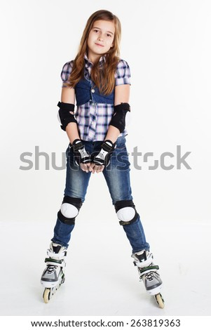 Cute girl in roller skates on a white background, studio shoot - stock photo