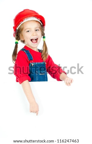 cute girl in the construction helmet with a white board - stock photo