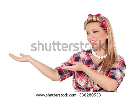 Cute girl indicating something in pinup style isolated on a white background - stock photo