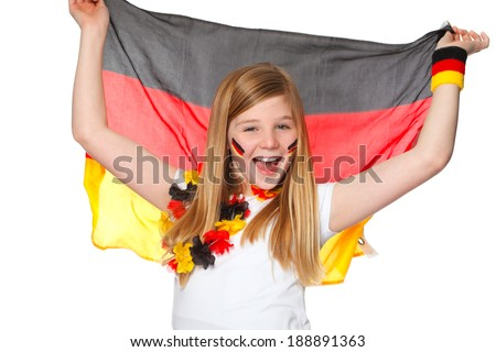 cute girl jubilates with german flag for german team - stock photo