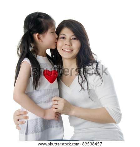 cute girl kissing her mother - stock photo