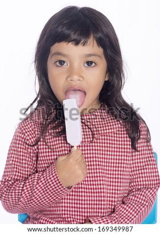 Cute girl licking ice cream over white background - stock photo