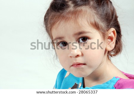 cute girl looking serious - stock photo