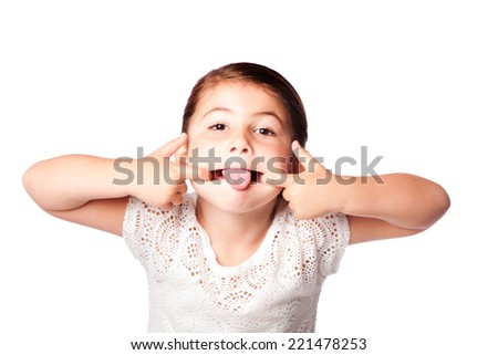 Cute girl making silly funny face, isolated. - stock photo