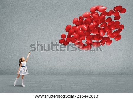 Cute girl of preschool age with bunch of balloons - stock photo
