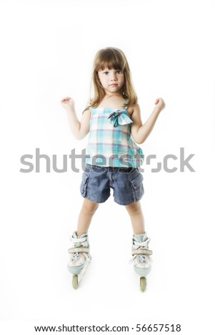 Cute girl on roller skates. Isolated on white background - stock photo