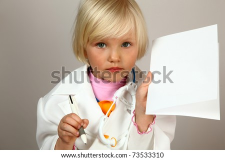 cute girl plays in doctor with prescription - stock photo
